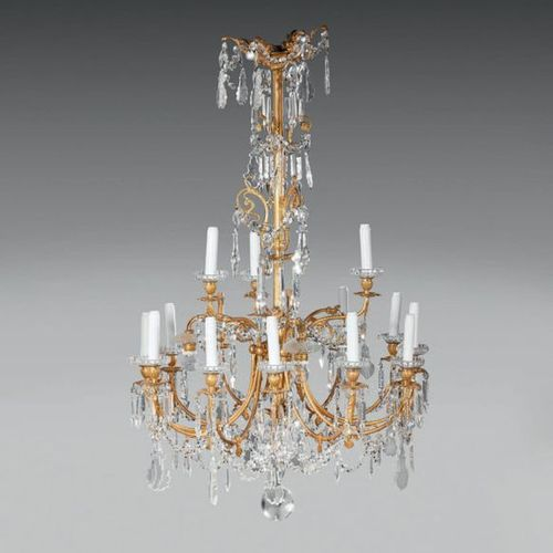 Chandelier in gilt bronze and cut crystal, with eighteen arms of light on two ro…