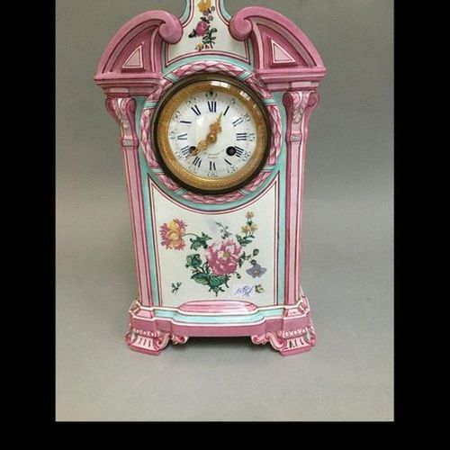 Pink and turquoise porcelain clock with flower decoration.  Shards and accidents
