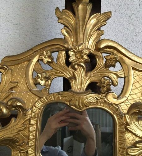 Mirror with gilded wooden brackets  H: 101 cm  L : 51 cm  Sold as is