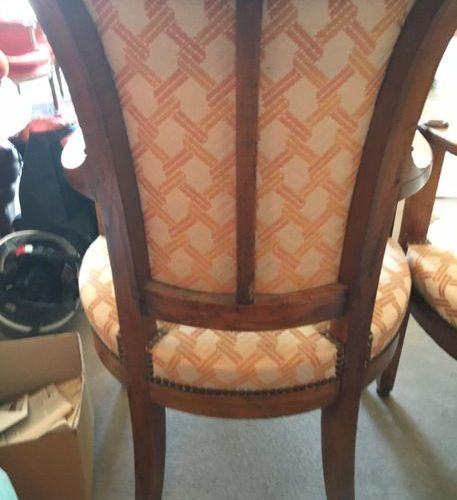 Pair of fruitwood armchairs, roll up backrest 