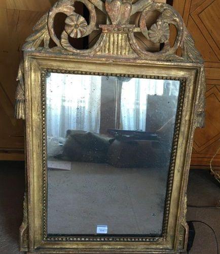 Small mirror with gilded wooden pediment  Around 1800  H: 64 cm  L : 40 cm  …