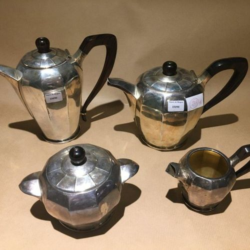 Silver tea service part by Tiffany including: teapot, pourer, covered sugar bowl…