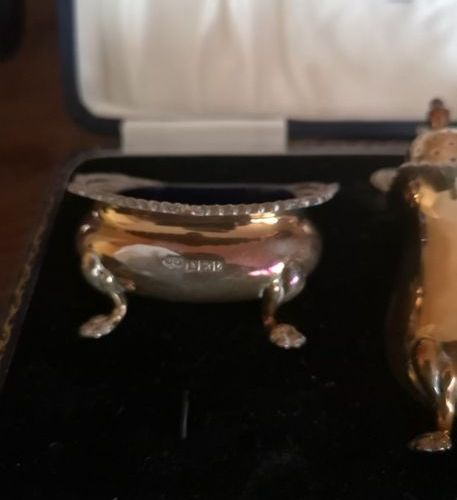 Lot in silvery metal including: teapot, curon, tea strainer, kettledrum  A case …