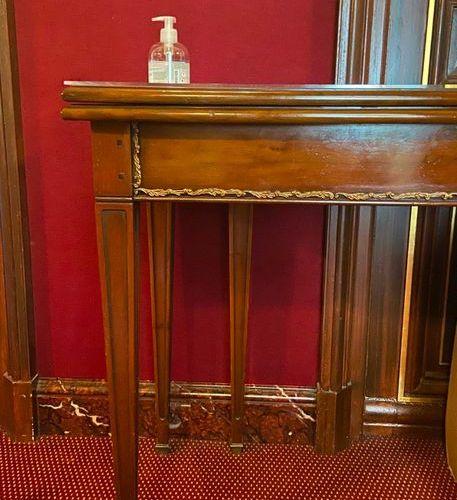 Rectangular console table in mahogany and mahogany veneer, ormolu ornamentation …