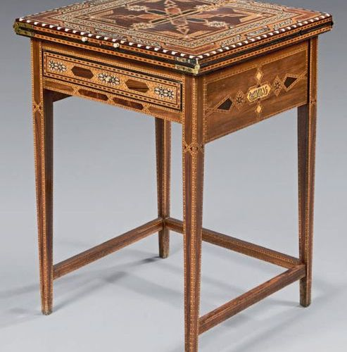 Transformation table with inlaid decoration on a rosewood background with geomet…