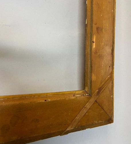 A gilded stucco channel frame, 19th century  74 x 59.5 x 10 cm  (Sold as is)