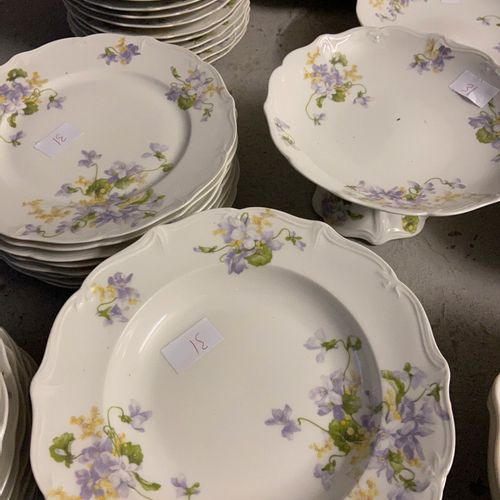 E. Bourgeois porcelain service with floral decoration comprising 8 soup plates, …