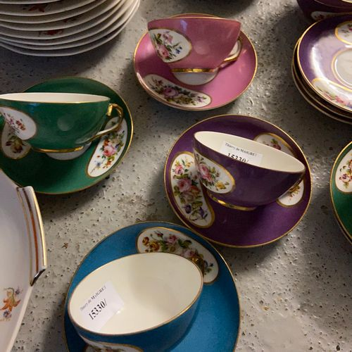 Porcelain service including 11 tea cups and 10 saucers.  A dish and 11 dessert p…