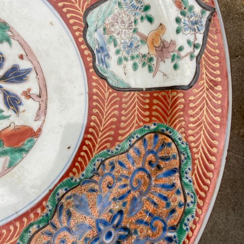 Porcelain dish with polychrome decoration of birds and foliage scrolls in medall…
