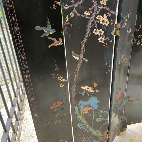 Four leaf lacquered Coromandel type folding screen  XIXth/ XXth century  122 x 2…