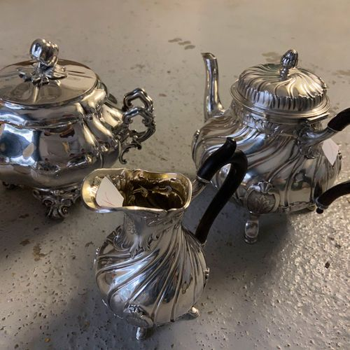 Silver 2 piece service including a teapot, and a milk jug.  A sugar bowl and its…