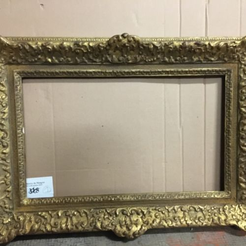 Carved and gilded fir wood frame. Louis XIV style, England, 19th century. 28,5 x…