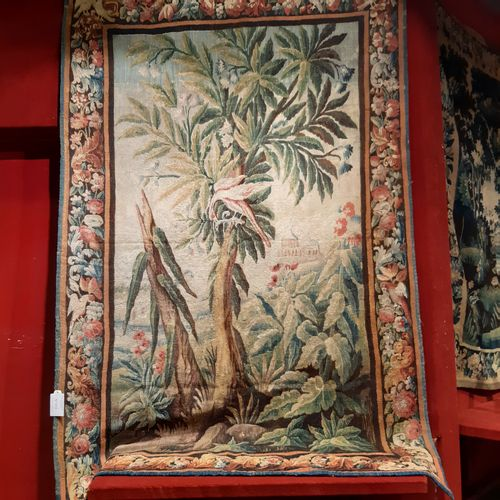 Green wool and silk tapestry decorated with an exotic tree with a bird devouring…