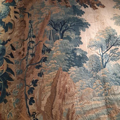 Tapestry in wool and silk decorated with a landscape with large trees between tw…