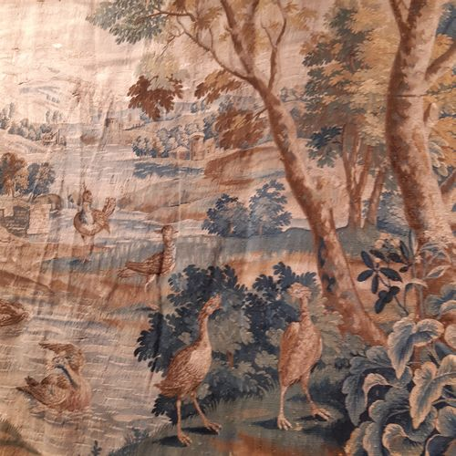 Wool and silk tapestry decorated with numerous birds, including a wader catching…