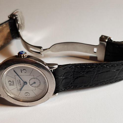 CARTIER MUST, montre dame circa 1980, boîtier rond 32 mm en argent Réf. 1815 1. …