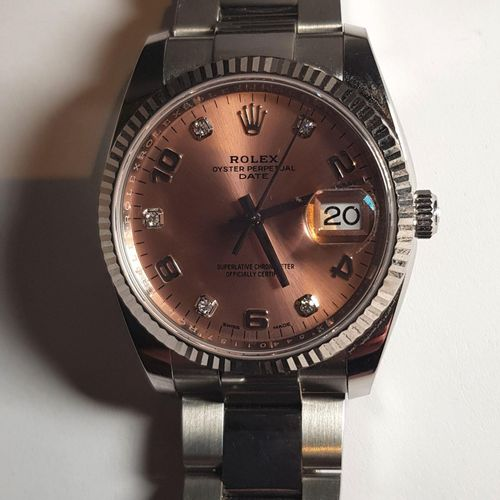 ROLEX OYSTER PERPETUAL DATE. Montre dame Réf.. Boîtier 34 mm et bracelet Rolesor…
