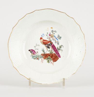 Tournai 18e. Ceramics: Deep plate in soft paste porcelain with polychrome decora…