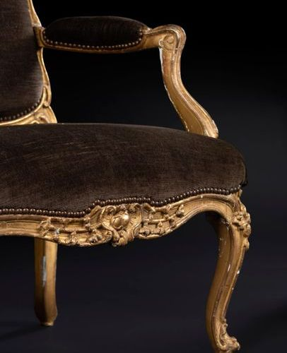 Pair of large moulded, carved and gilded wooden armchairs with flat backs, of an…
