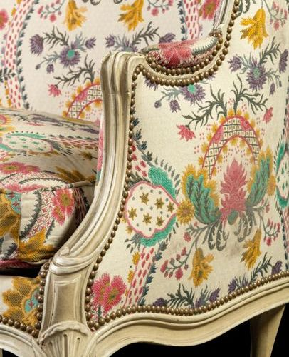 Moulded and painted wooden sofa, the corbelled backrest extended by moving armre…