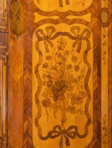 Secretary with a flap in flower marquetry with an eventful shape on the front an…