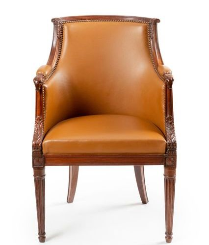 Solid mahogany armchair, molded and carved, with a curved backrest with overturn…