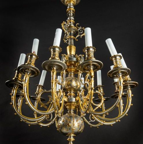 Beautiful silver and gilt bronze chandelier with twelve lights and decoration of…