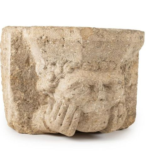 Limestone corbel carved with a curly haired man's head resting on his hands. 14t…