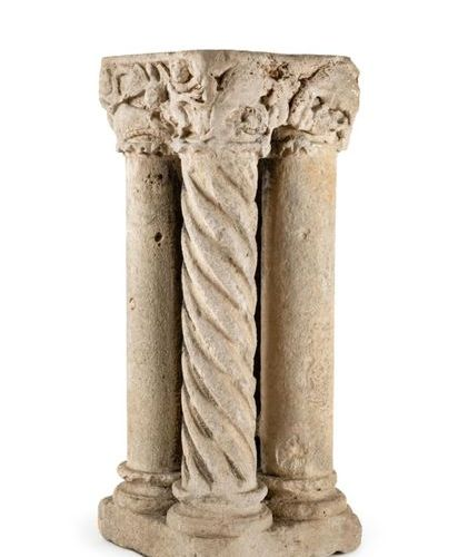 Set of four limestone columns with carved capitals on all sides. Two columns wit…