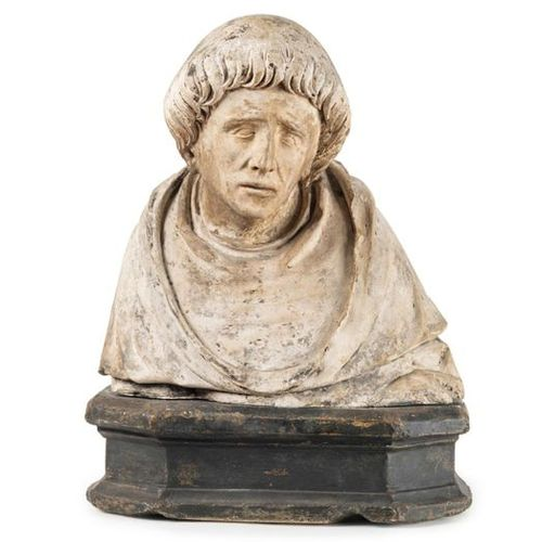 Bust of saint monk in limestone carved with traces of polychromy. Toned head wit…