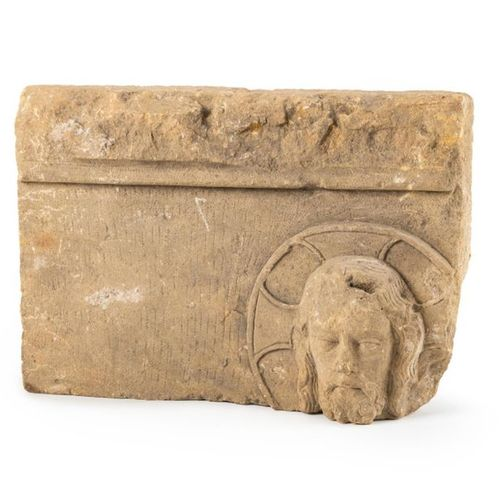 Fragment of a carved limestone bas relief representing a nimbed head of Christ. …