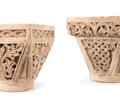 Pair of limestone capitals carved on all sides in depth; flared baskets with rec…
