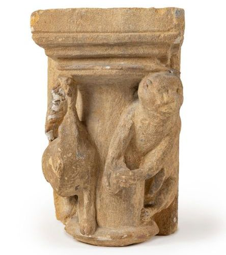 Engaged limestone capital carved with a monkey and a high footed animal with an …