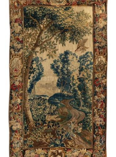 Brussels Tapestry with undergrowth decoration, the border decorated with flowers…