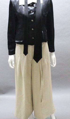 Sonia RYKIEL  Lot composed of a short black satin jacket, small ecru collar, sin…