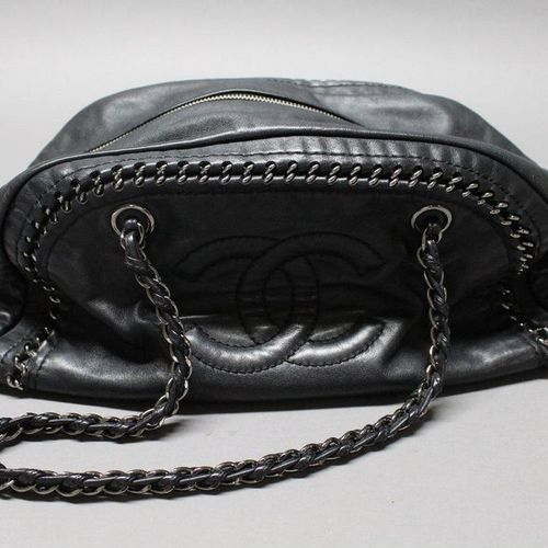 "CHANEL circa 2003  33cm ""Chain All Around"" bag in black lambskin leather with a …"