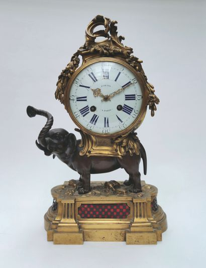 JEWELRY - WINDOW OBJECTS - TABLES - SCULPTURES - ART AND FURNITURE OBJECTS including a beautiful clock with an elephant movement signed Fortin