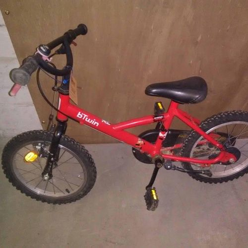 Bike blue; bike brand ROCKRIDER; Child bike brand Btwin red. Service giving : CO…