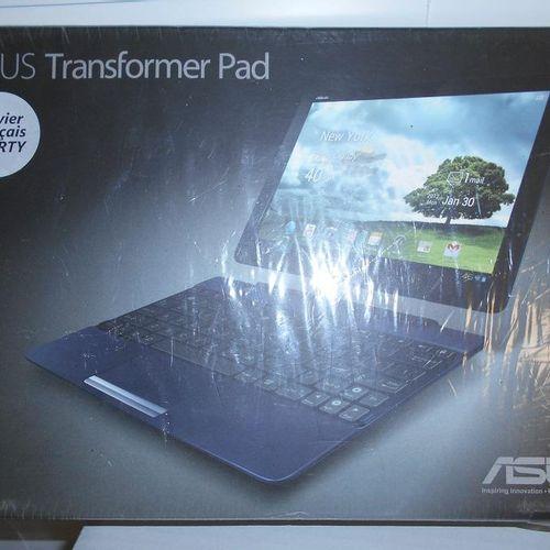 1 tablette ASUS TRANSFORMER PAD dans son emballage. Lieu de dépôt : MAGASIN DOMA…