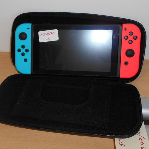 NINTENDO SWITCH in its case, without base or charger. Deposit location: MAGASIN …