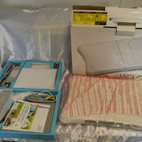 Set includes 3 NINTENDO WII consoles: 1 with WII Fit plus tray, in its box, as n…