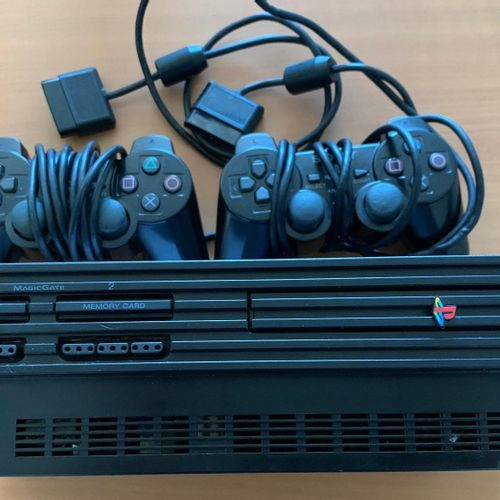 SONY PS2 with connectors and 2 controllers. Drop off location: MAGASIN DOMANIAL …