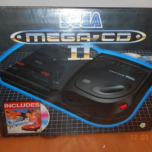 SEGA MEGA CD II game console with connectors and 4 games. Visits and pick up onl…